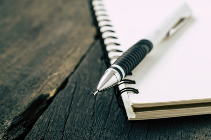 image of a notebooks and pencil on the desk